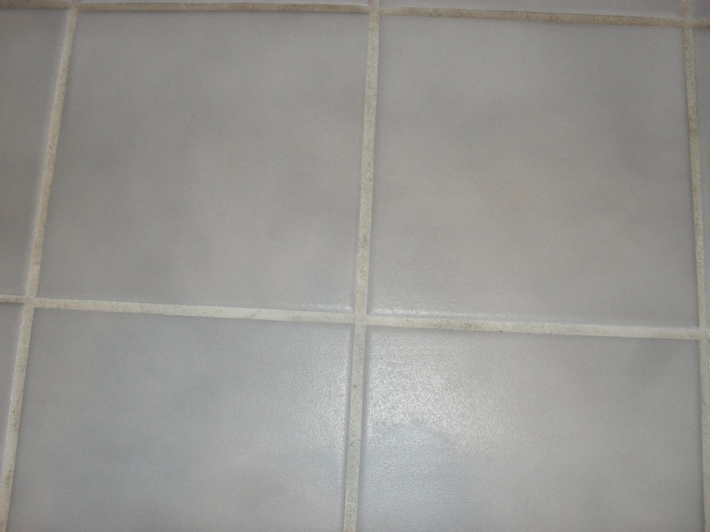 Powder bleach on tile to get rid of grout