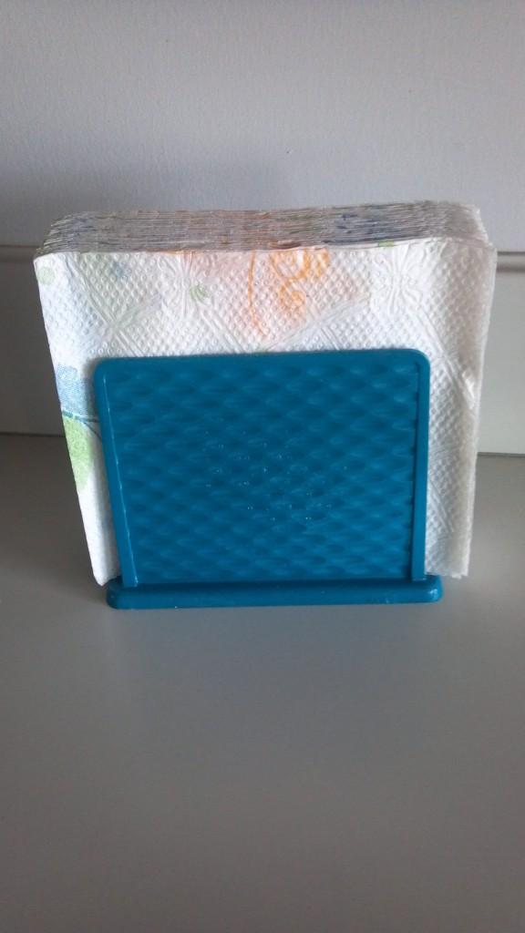 Spray painting a napkin holder craft