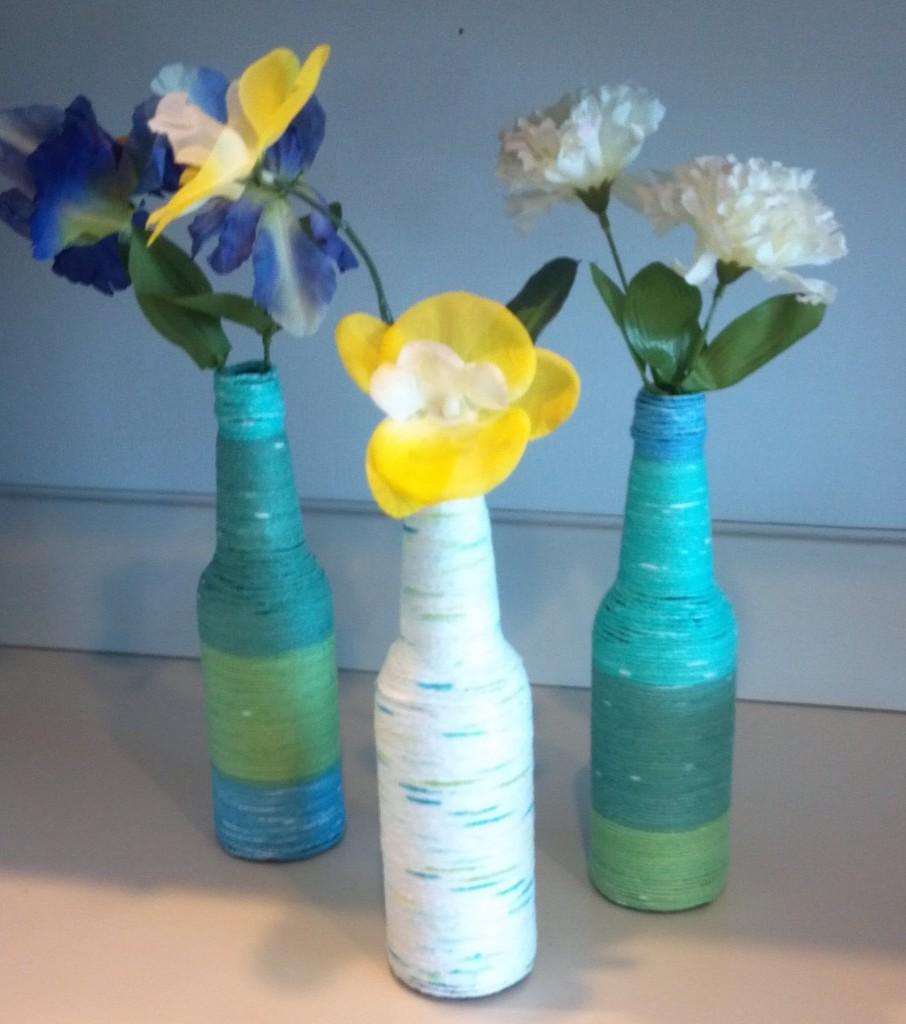 Yarn flower vase tasteful space for Glass bottle crafts to make