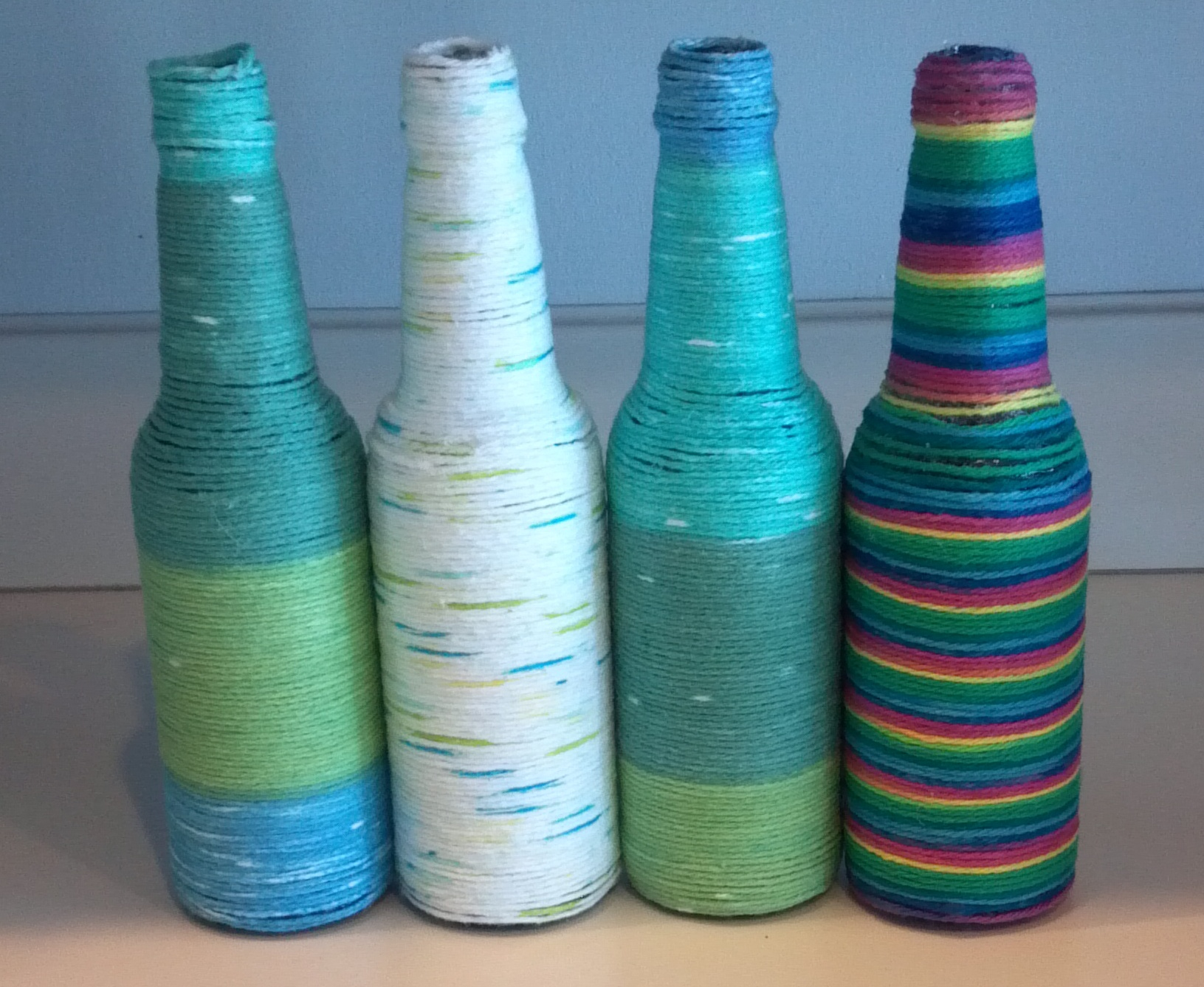 yarn and glass bottle craft project