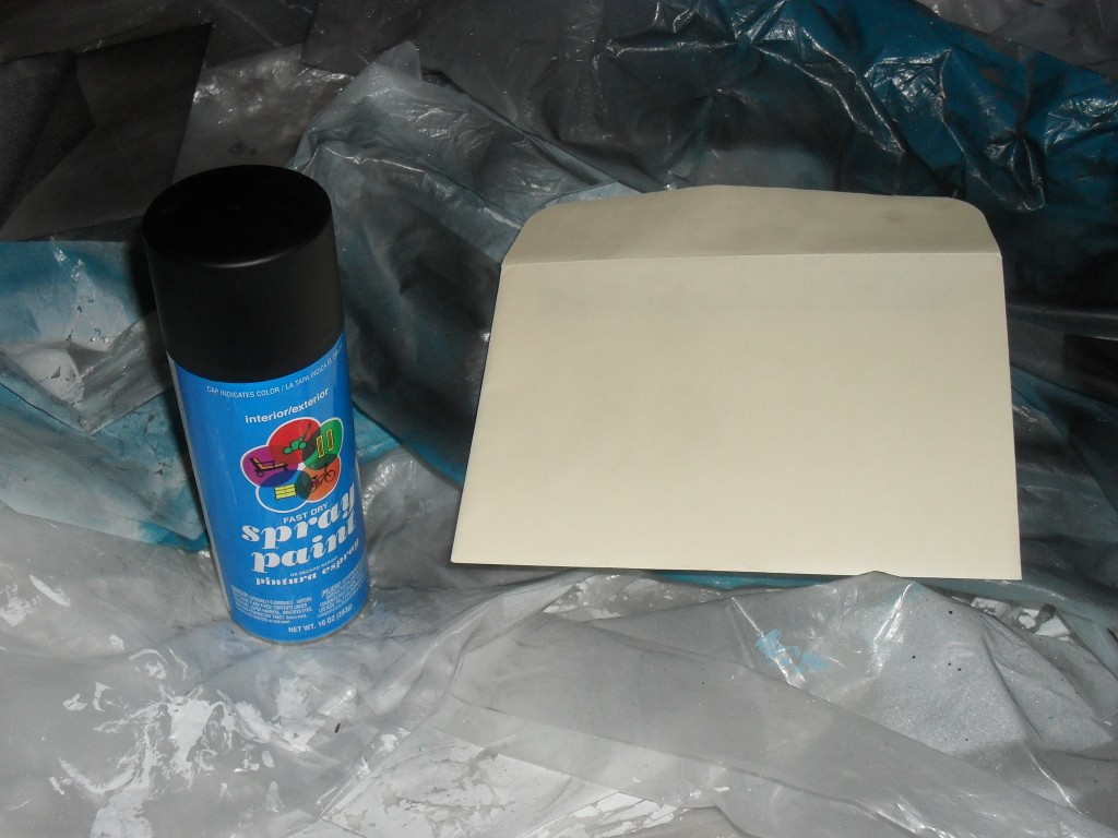 spray painting an envelope