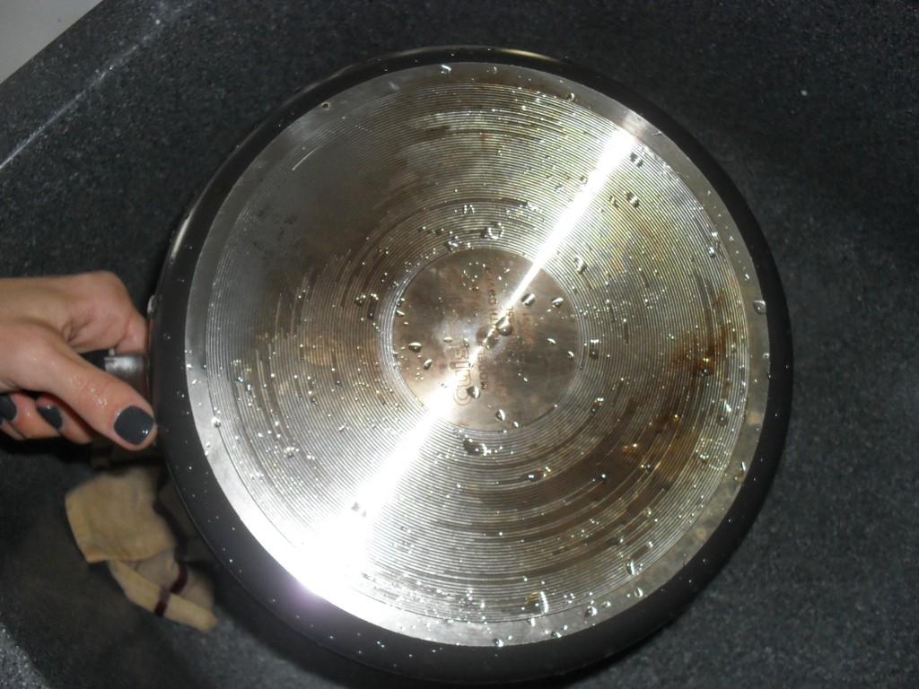 using a magic eraser on a pan
