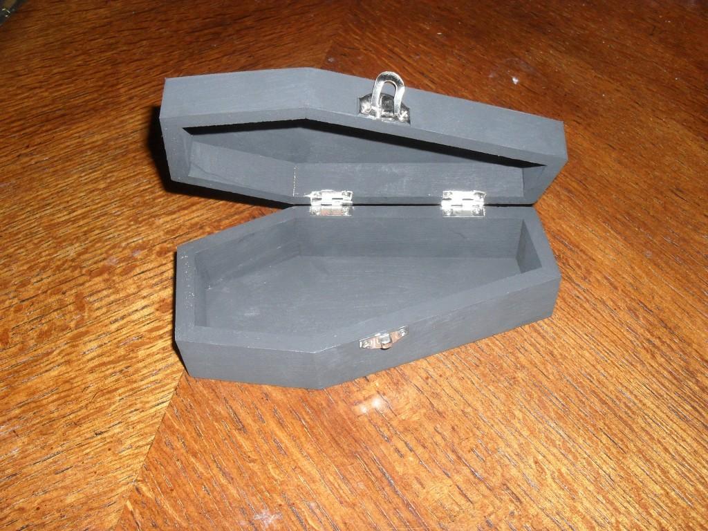 black wooden coffin