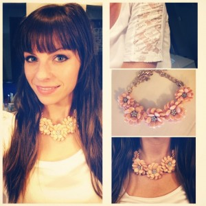 A coral statement necklace with a touch of lace adds a delicate touch to any wardrobe