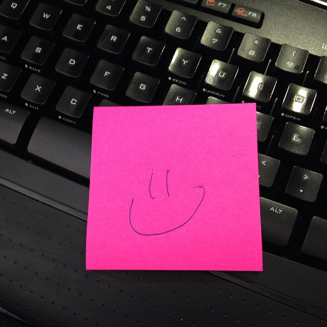 Smiley face sticky note on Monday