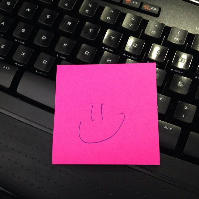 Smiley face sticky note on Monday