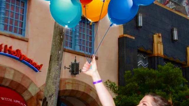 Holding onto Mickey balloons🎈I love Disney memory maker!