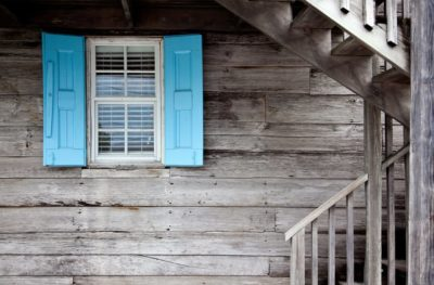renting a house blue shade window