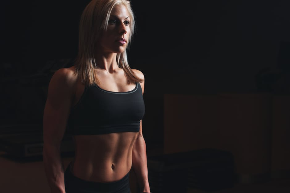 Six Pack Abs woman in black fitness