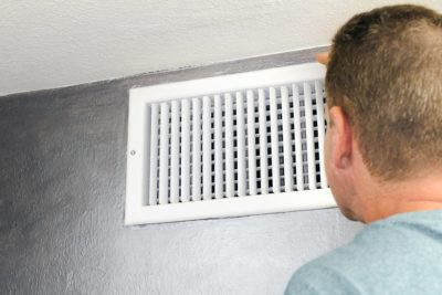hvac air temp man staring at vent