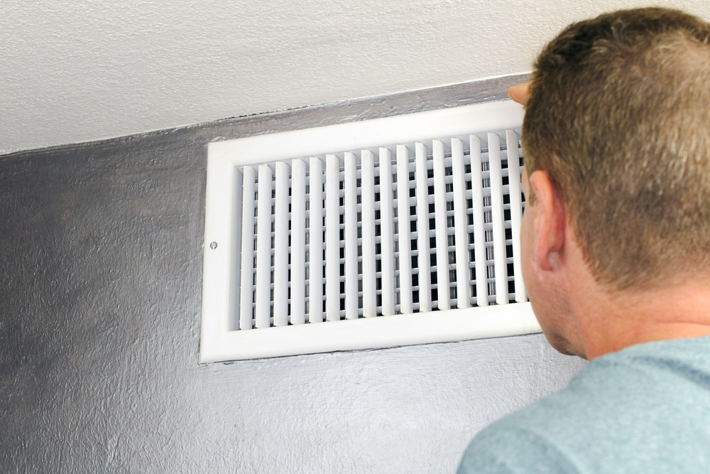 hvac air temp man staring at vent