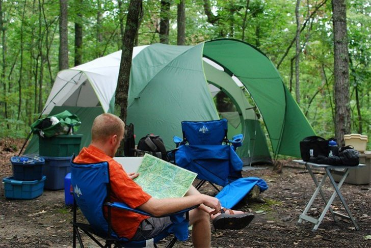 Guidelines For Camping sitting on chair outside