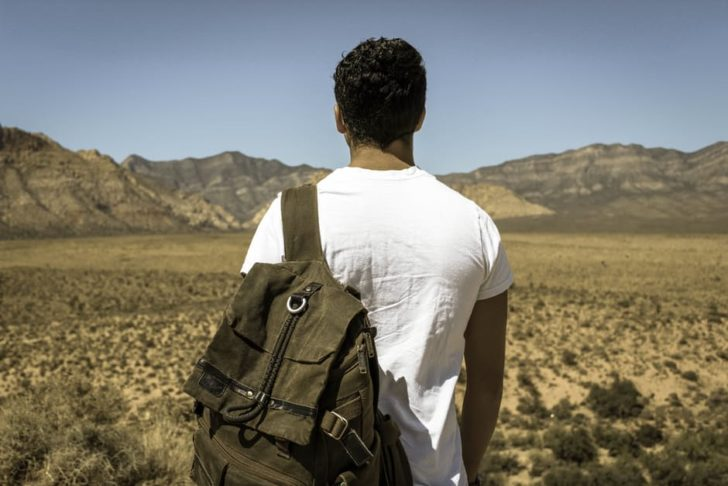 Travelling Student looking out at mountains