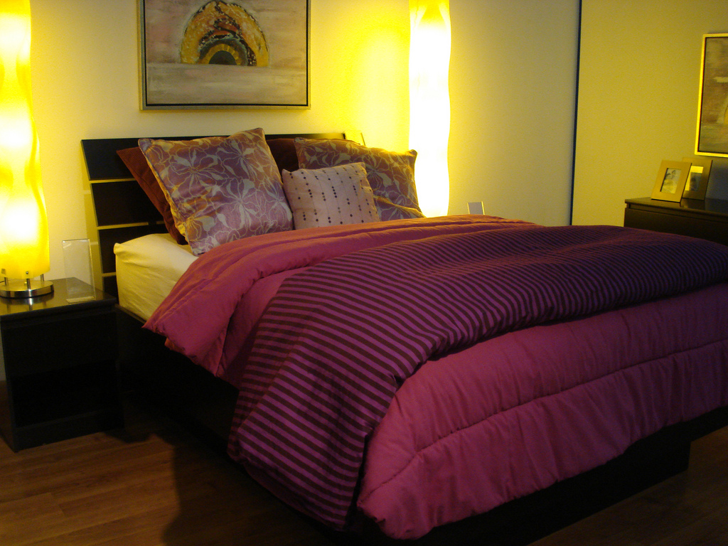 Cozy Bedroom warm purple sheets