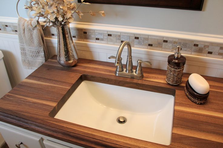bathroom spa sink with wooden counter top