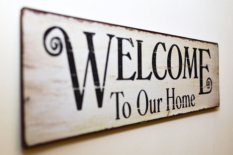 Buying A Home welcome to our home sign
