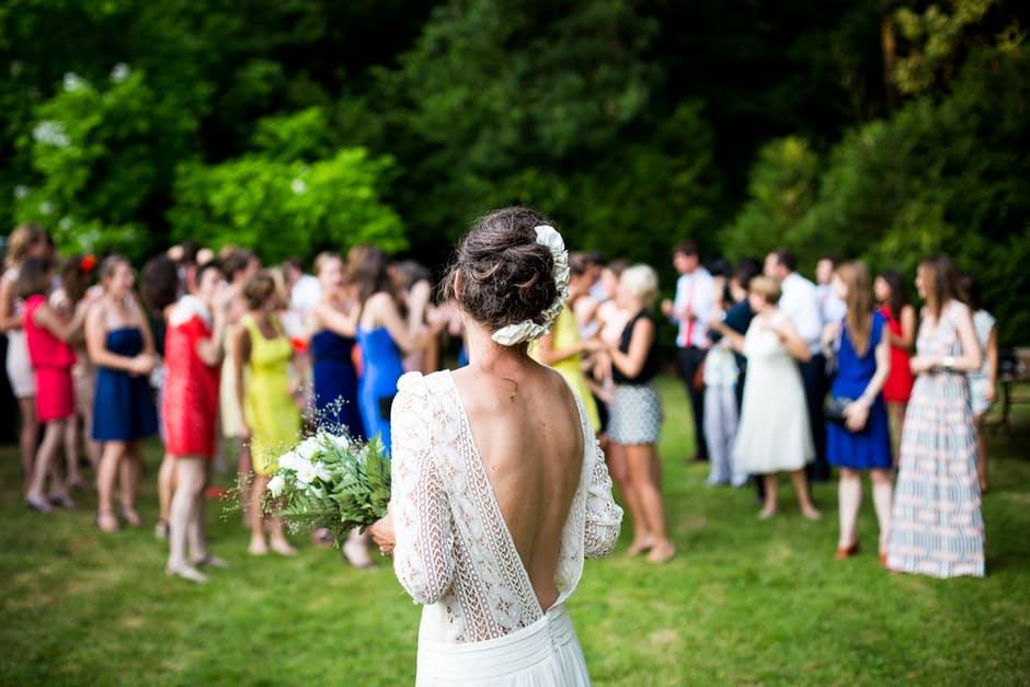 Wedding Season bride tossing bouquet