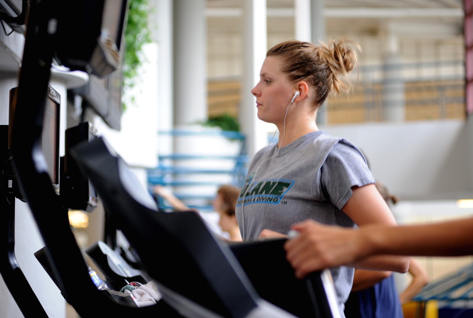 Fitness Goals woman running on treadmill