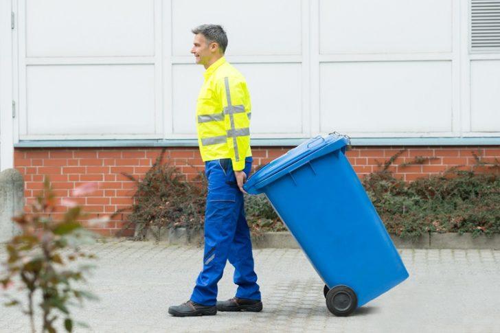 Rent Bin Hire man pulling bin
