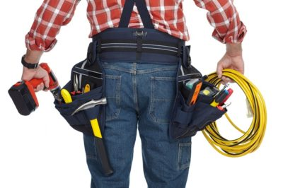 Electrical Contractors reaching into tool belt