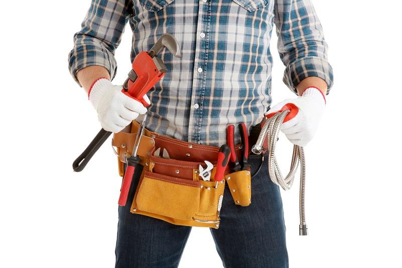Registered Plumber with tool belt