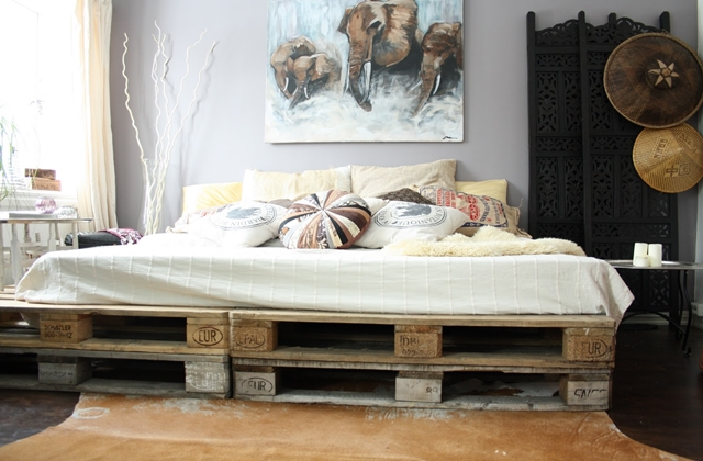 Green recycled furniture skids on bed