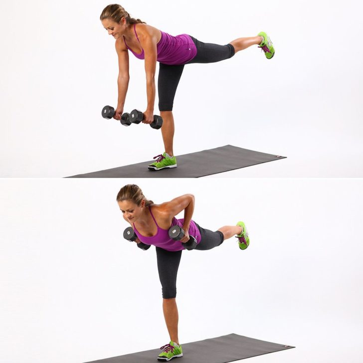 Kettlebell Workouts woman balancing with weights