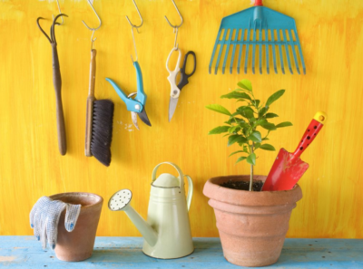 Cheap Garden Tools yellow painted wall