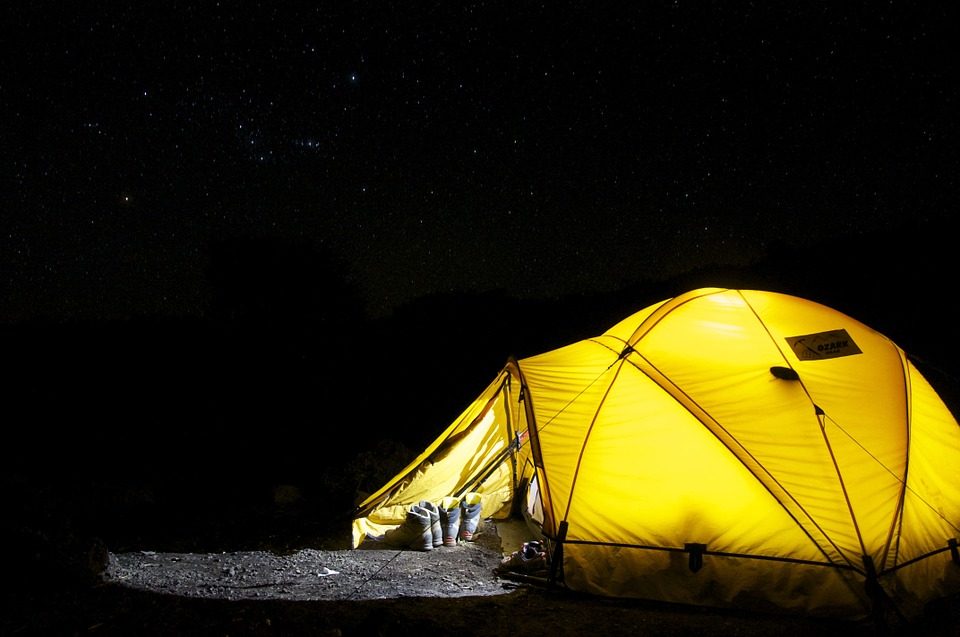 How to Camp and Actually Enjoy It tent at night