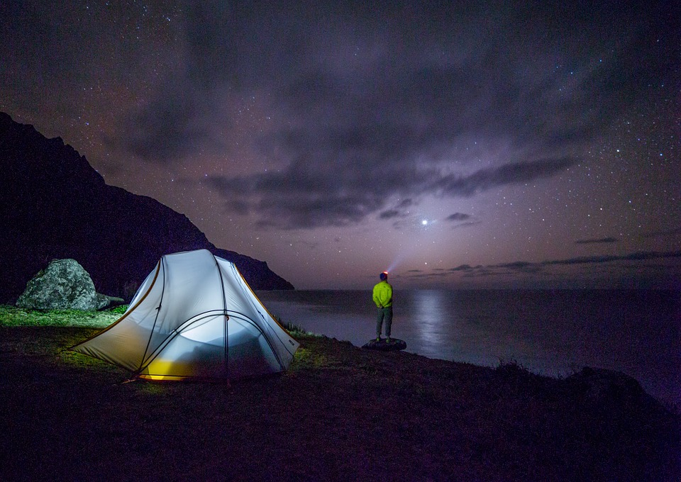 How to Camp and Actually Enjoy It tent and man