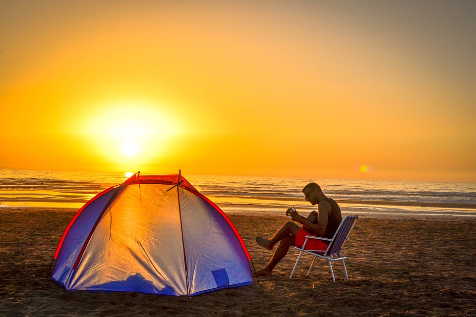 How to Camp and Actually Enjoy It tent on beach