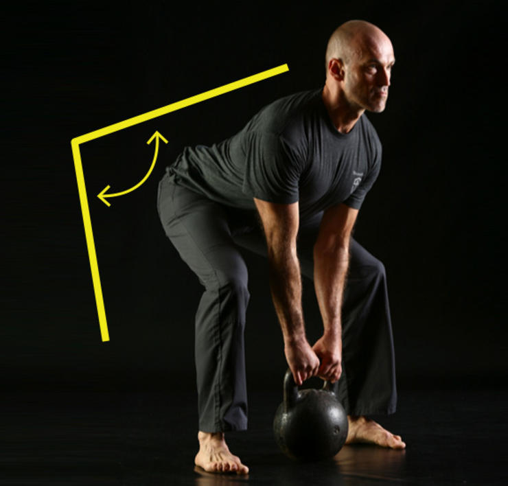 Kettlebell Workouts man lower stance