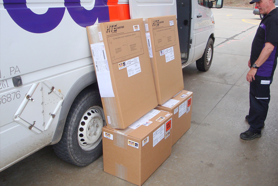 Safe Delivery fed ex boxes against truck