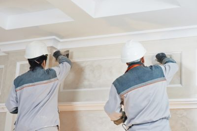 Install a Cornice men working on wall
