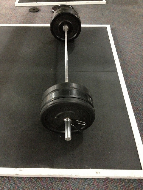 Home Gym loaded barbell on ground