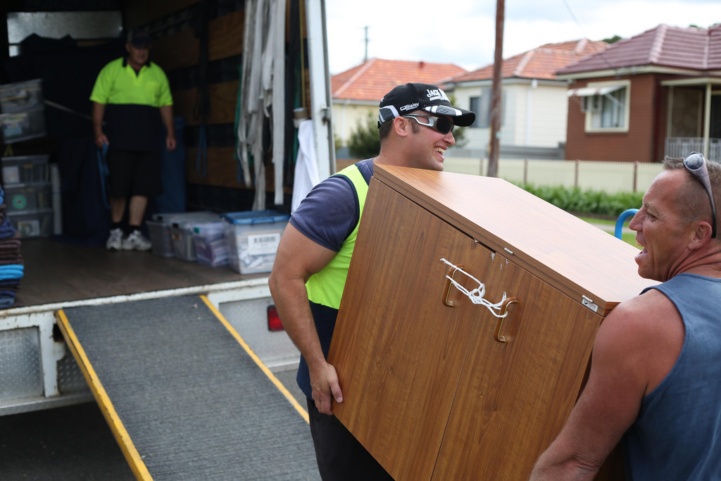 Buying A House movers moving happily