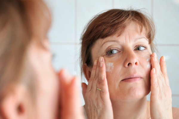 Skin Care Tips applying lotion on face