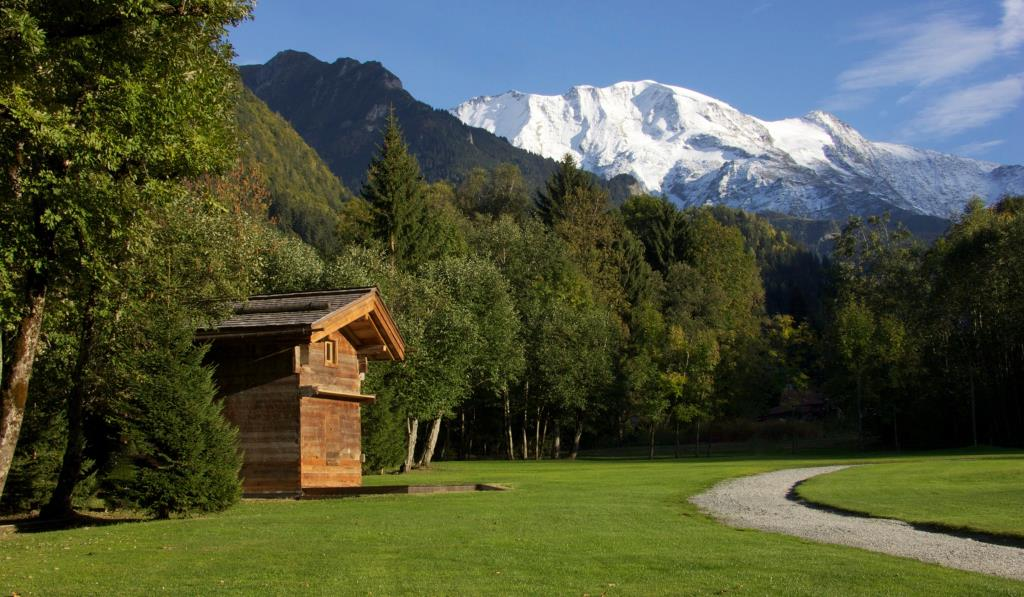 Breathtaking Places in Europe log cabin on grass