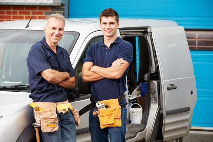 Plumbing Services men cross-armed standing
