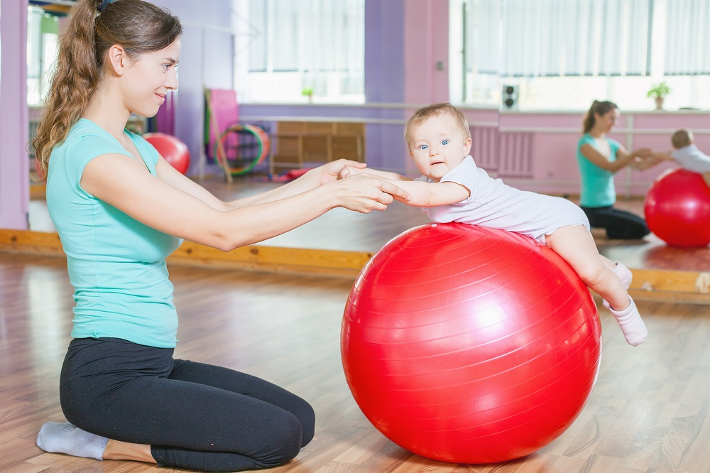 Fitball baby on top of exercise ball