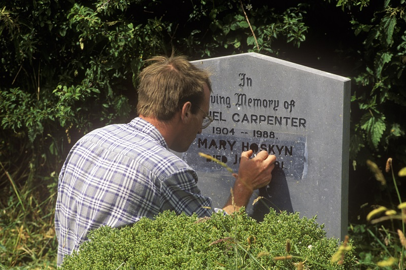 Granite Monuments man inscribing on stone