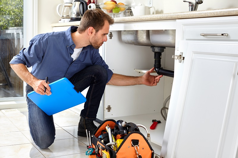 Right Plumber checking sink drain pipe