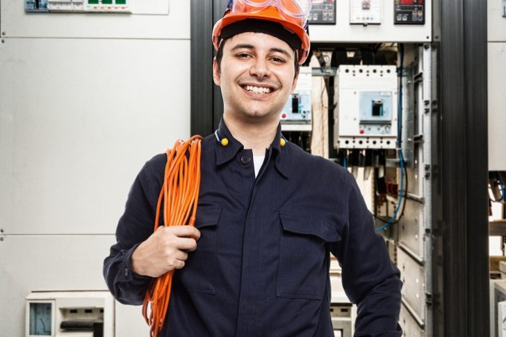 Qualified Electrician smiling and holding cable