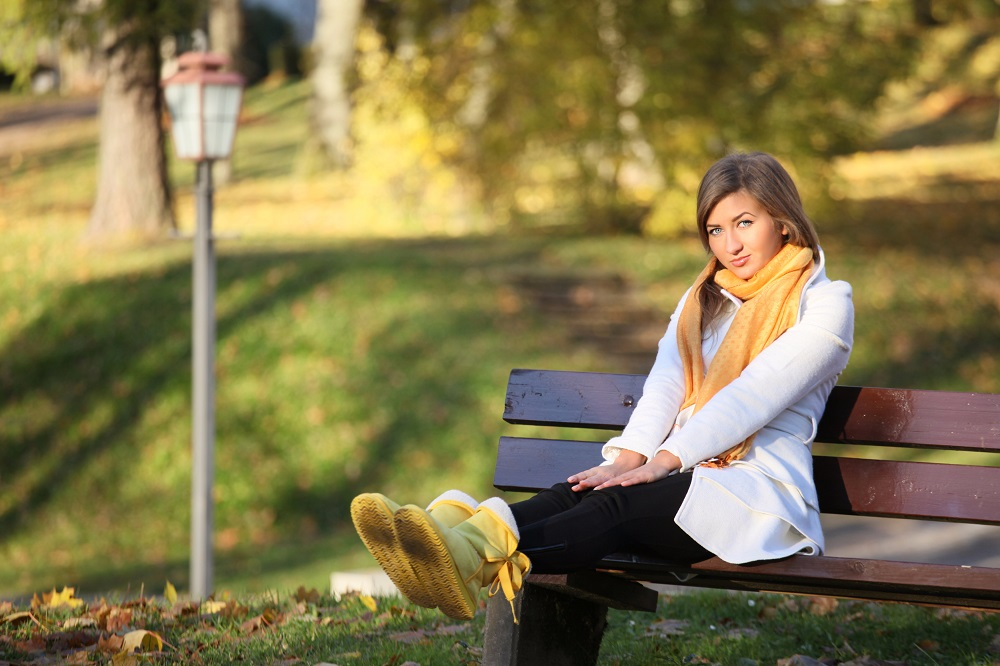 Ugg Boots on woman sitting on bench