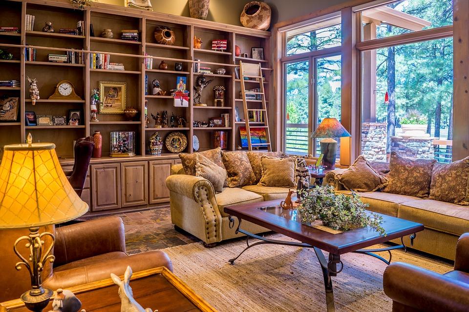 small room natural lighting bookshelf windows