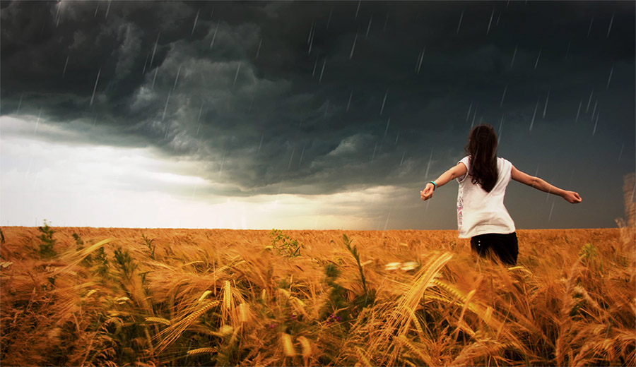 Social Anxiety woman in field storm coming
