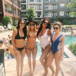 uv spray tanning girls by pool