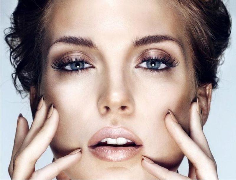 youthful skin on woman touching face