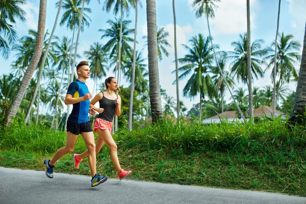 outside running couple palm trees