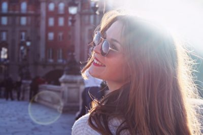 woman happy outside sunglasses sunshine